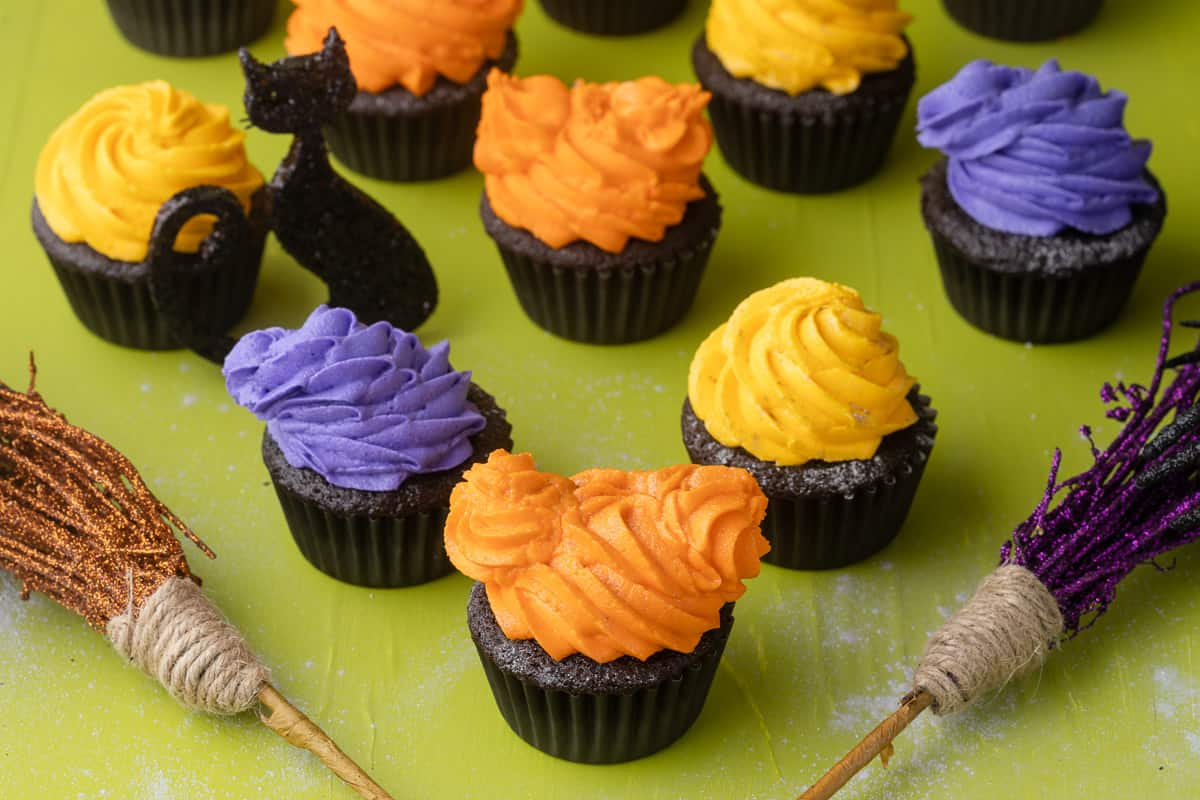 Halloween cupcakes decorated to look like the Sanderson sisters from hocus pocus.