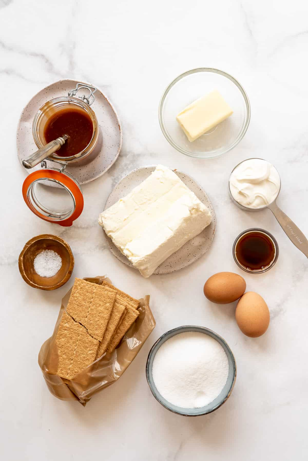 ingredients for salted caramel cheesecake bars.