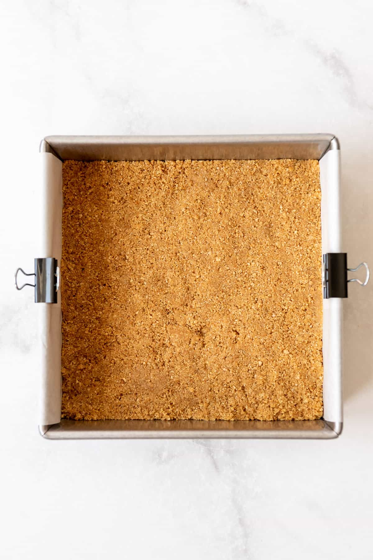 a graham cracker crust pressed into a square 8-inch pan.