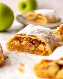 a piece of homemade apple strudel with raisins.