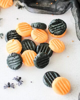 a pile of homemade black and orange Halloween candy mints.