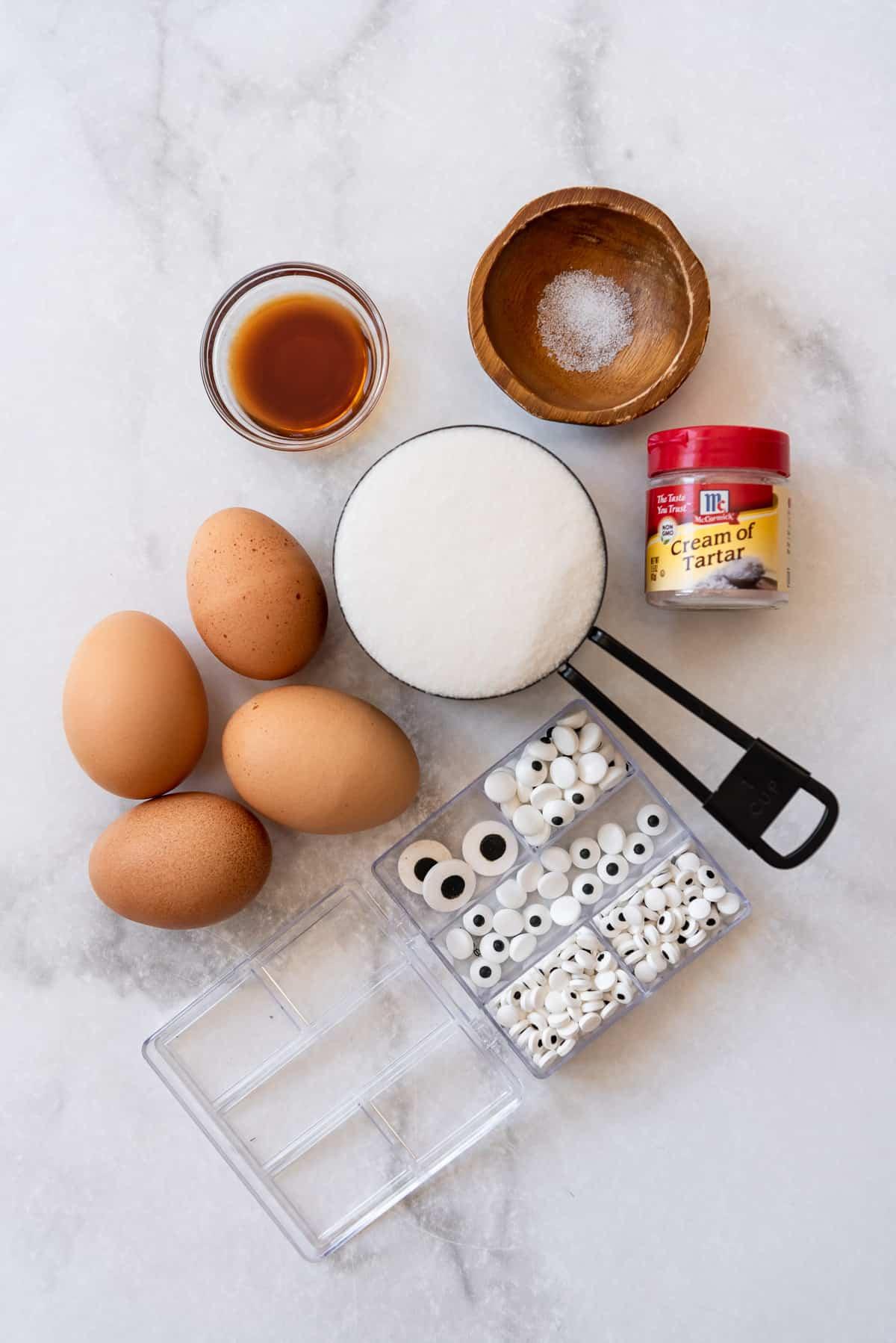 Ingredients for making meringue cookies for Halloween.