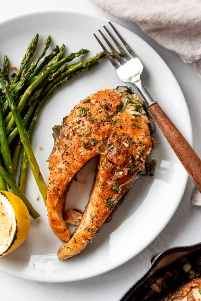 A plate of salmon with roasted asparagus.